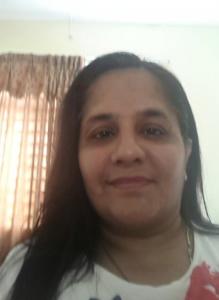 Gurdev Kaur Indar Singh caring to someone CaregiverAsia: Book Now